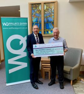 John Quinn presents cheque to St Andrew's Hospice Fundraiser Bobby Mason